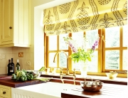 Flower vase placed near the window with sunlight reflecting into the kitchen